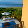 Lifestyle Photography of Umbrella, pool and beach on Kiawah Island
