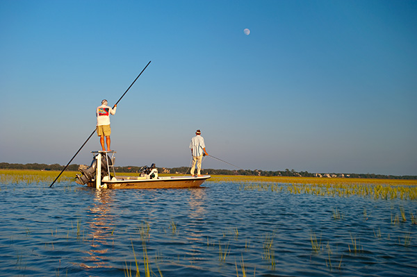 Captain Newman Weaver of Georgetown Kingfisher poling his skiff after tailing redfish in North Inlet