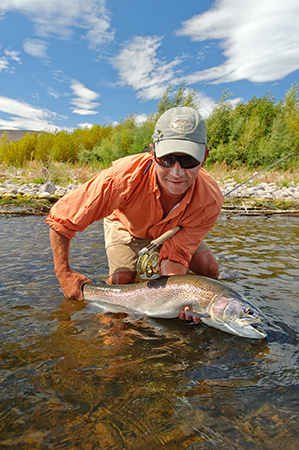 Gunnison River Guides owner Jason Booth with a 33 inch Gunnison River rainbow trout